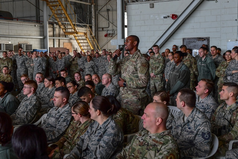 Staff Sgt. Michael S. Barron asks Air Force Chief of Staff Gen. David L. Goldfein and Chief Master Sgt. of the Air Force Kaleth O. Wright a question during an all-call at Incirlik Air Base, Turkey, Dec. 23, 2018.