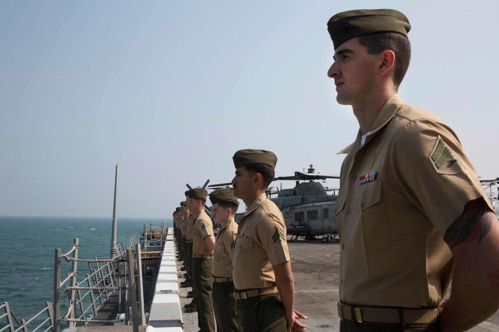 U.S. Marines with the 13th Marine Expeditionary Unit (MEU), man the rails of the San Antonio-class amphibious transport dock USS Anchorage (LPD 23), Dec. 22, 2018. The Anchorage, assigned to the Essex Amphibious Ready Group (ARG), is conducting a partnership strengthening visit to Visakhapatnam, India.  The Essex ARG and 13th MEU are a capable and lethal Navy-Marine Corps team deployed to the U.S. 7th Fleet area of operations to support regional stability, reassure partners and allies and maintain a presence postured to respond to any crisis ranging from humanitarian assistance to contingency operations.