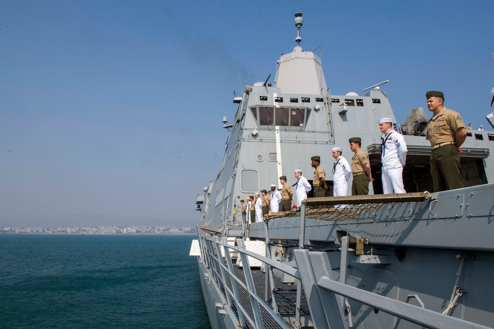 Sailors assigned to the San Antonio-class amphibious transport dock ship USS Anchorage (LPD 23) and Marines assigned to the 13th Marine Expeditionary Unit (MEU) man the rails during a port visit to Visakhapatnam while on a deployment of the Essex Amphibious Ready Group (ARG) and 13th MEU. The Essex ARG/ 13th MEU is a capable and lethal Navy-Marine Corps team deployed to the 7th Fleet area of operations to support regional stability, reassure partners and allies and maintain a presence postured to respond to any crisis ranging from humanitarian assistance to contingency operations.