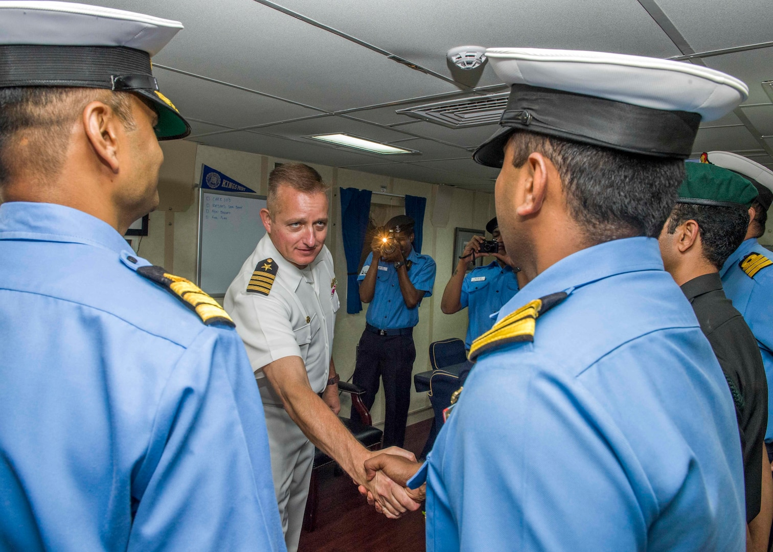Capt. Dennis Jacko, from Sayerville, N.J., commanding officer of the San Antonio-class amphibious transport dock ship USS Anchorage (LPD 23), greets distinguished visitors from the Indian military during a port visit to Visakhapatnam, India, while on a deployment of the Essex Amphibious Ready Group (ARG) and 13th MEU. The Essex ARG/ 13th MEU is a capable and lethal Navy-Marine Corps team deployed to the 7th fleet area of operations to support regional stability, reassure partners and allies and maintain a presence postured to respond to any crisis ranging from humanitarian assistance to contingency operations.