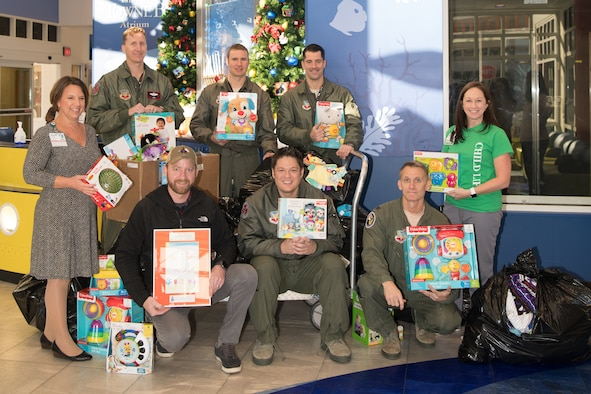 149th Fighter Squadron partners with community to donate toys to local children's hospital