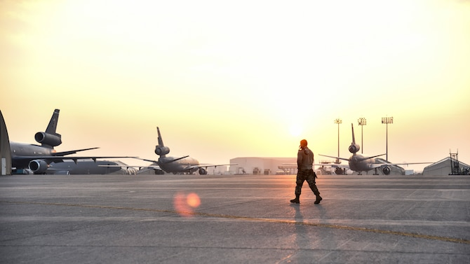 U.S. Air Force Senior Airman Devon Gilbert, 380th Expeditionary Aircraft Maintenance Squadron E-3 AWACS Sentry crew chief, walks down the flight line at Al Dhafra Air Base, United Arab Emirates, Dec. 20, 2018. The crew chief's extensive list of responsibilities including for pre-, post- and thru-flight checks, and well as various inspections, allows them to fully understand their vital role, making them jacks-of-all-trades when it comes to repairing the aircraft. (U.S. Air Force photo by Senior Airman Mya M. Crosby)