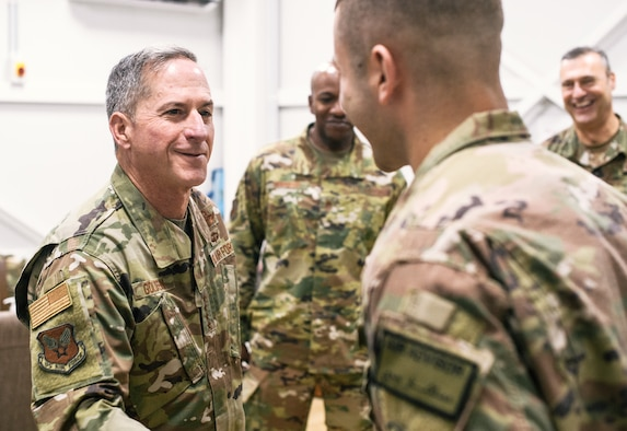 Air Force Chief of Staff Gen. David L. Goldfein congratulates a deployed Airman for superb performance at an undisclosed location in Southwest Asia, Dec. 22, 2018. Goldfein, Chief Master Sgt. of the Air Force Kaleth O. Wright, and U.S. Air Forces Central Command commander Lt. Gen. Joseph Guastella traveled throughout U.S. Central Command's area of responsibility thanking Airmen for their sacrifice, recognizing outstanding performers and listening to Airmen during the holiday season. (U.S. Air Force photo by Staff Sgt. Jordan Castelan)