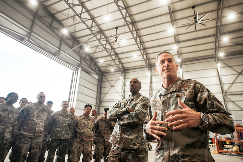 "Air Force Chief of Staff Gen. David L. Goldfein and Chief Master Sgt. of the Air Force Kaleth O. Wright talk with deployed Airmen at an undisclosed location in Southwest Asia, Dec. 22, 2018. Goldfein and Wright, ""The Chiefs Team,"" visited Airmen throughout U.S. Central Command's area of responsibility to offer guidance, thanks, and listen to Airmen. (U.S. Air Force photo by Staff Sgt. Jordan Castelan)"