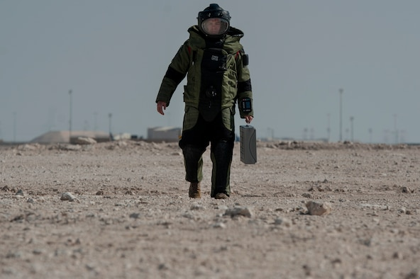 Tech. Sgt. Michael Case, 379th Expeditionary Civil Engineer Squadron explosive, ordnance, and disposal (EOD) team member, approaches a simulated vehicle borne improvised explosive device (VBIED) while wearing an EOD 10 Bomb Suit, during a VBIED response training exercise Dec. 18, 2018, at Al Udeid Air Base, Qatar. Training participants utilized an F6A robotic platform, a bomb suit, and other specific tools to disrupt a VBIED during the exercise. (U.S. Air Force photo by Tech. Sgt. Christopher Hubenthal)