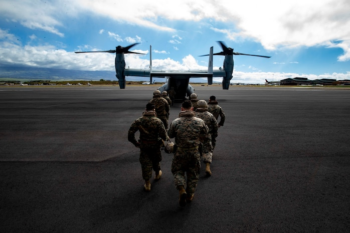 U.S. Reconnaissance Marines with Detachment 4th Force Reconnaissance Company returns to an MV-22B Osprey with Marine Medium Tiltrotor Squadron 268, Marine Aircraft Group 24, after transporting Marine Toys for Tots Donations from Marine Corps Base Hawaii to the Salvation Army Centers on the island of Maui, Dec. 20, 2018. The mission of the Marine Toys for Tots Program is to collect new unwrapped toys and distribute those toys to less fortunate children at Christmas. Through the gift of a new toy, Marine Toys for Tots Program help bring the joy of Christmas and send a message of hope to America's less fortunate children.