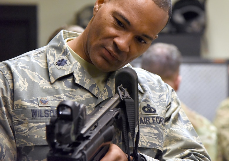 U.S. Air Force Lt. Col. Billy Wilson, 334th Training Squadron commander, inspects an M-320 grenade launcher during the 81st Security Forces Squadron Day In The Life Of A Defender event at Keesler Air Force Base, Mississippi, Dec. 18, 2018. The event, which was the kick-off for the Year Of The Defender, allowed the 81st SFS to showcase their training and mission capabilities to Keesler leadership. (U.S. Air Force photo by Kemberly Groue)