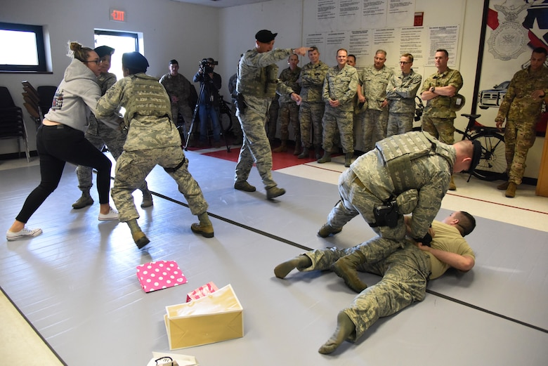 Members of the 81st Security Forces Squadron participate in a mock response to a domestic disturbance during the 81st SFS Day In The Life Of A Defender event at Keesler Air Force Base, Mississippi, Dec. 18, 2018. The event, which was the kick-off for the Year Of The Defender, allowed the 81st SFS to showcase their training and mission capabilities to Keesler leadership. (U.S. Air Force photo by Kemberly Groue)