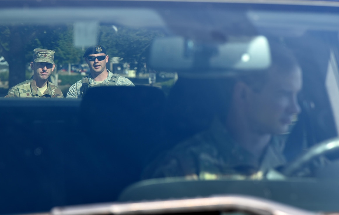 U.S. Air Force Maj. Bruce Hebert, 81st Contracting Squadron commander, and Senior Airman Zachary Vega, 81st Security Forces Squadron unit scheduler, participate in a mock traffic stop during the 81st SFS Day In The Life Of A Defender event at Keesler Air Force Base, Mississippi, Dec. 18, 2018. The event, which was the kick-off for the Year Of The Defender, allowed the 81st SFS to showcase their training and mission capabilities to Keesler leadership. (U.S. Air Force photo by Kemberly Groue)