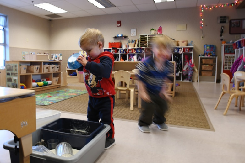 Jackson Scott, the son of Staff Sgt. Matthew Scott a 372nd Training Squadron professional military education instructor, cleans his bowl after snack time at the McRaven Child Development Center on Ellsworth Air Force Base, S.D., Dec. 6, 2018. The afternoon is not just fun and games; the toddlers are taught to wash their hands and clean up their play spaces. (U.S. Air Force Photo by Airman 1st Class Christina Bennett)