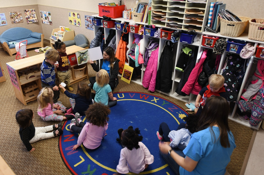 Crystal Emmons, a 28th Force Support Squadron program technician, reads to her class in room 138 at the McRaven Child Development Center on Ellsworth Air Force Base, S.D., Dec. 6, 2018. During the afternoon, the children enjoyed playtime, dance parties, reading and nutritious snacks – all before it was time to go home. (U.S. Air Force photo by Airman 1st Class Christina Bennett)
