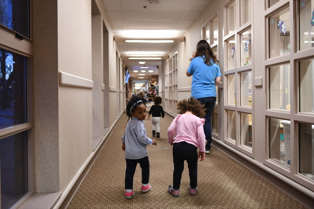 After a long day of playing and learning, the toddlers make their way to another room to be picked up by their parents at the McRaven Child Development Center on Ellsworth Air Force Base, S.D., Dec. 6, 2018. The CDC provides military parents with a clean, safe and loving place to bring their children while they work to accomplish the mission. (U.S. Air Force photo by Airman 1st Class Christina Bennett)
