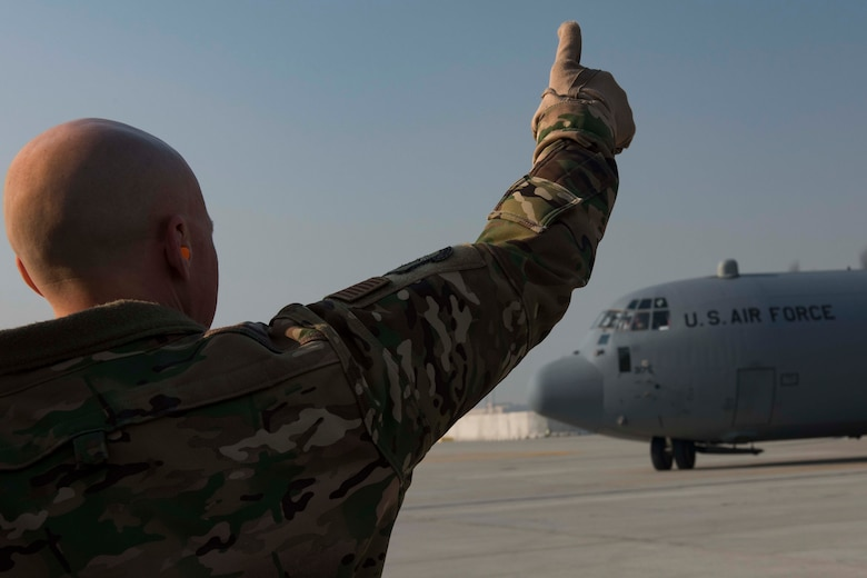 Air Force Col. Joseph Miller, 455th Air Expeditionary Wing vice commander, greets an aircraft carrying Air Force Chief of Staff David L. Goldfein and the Chief Master Sgt. of the Air Force Kaleth O. Wright during a recent visit to Bagram Airfield, Afghanistan, Dec. 25, 2018. Airmen were given the opportunity to discuss changes occurring in the Air Force with leadership during the visit. (U.S. Air Force photo by Senior Airman Kaylee Dubois)