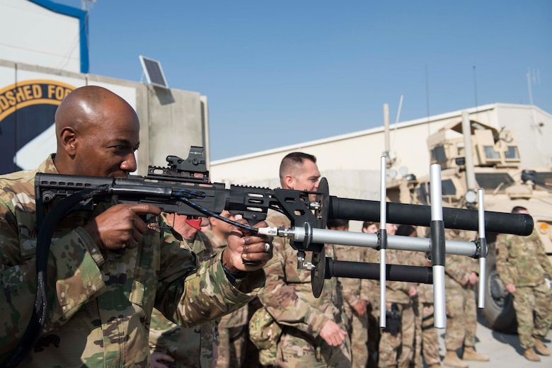 "Chief Master Sgt. of the Air Force Kaleth O. Wright gets a hands-on demonstration of a counter-unmanned aircraft system known as a 'Drone Defender' during a visit with the 455th Expeditionary Security Forces Squadron at Bagram Airfield, Afghanistan, Dec. 25, 2018. Wright and Air Force Chief of Staff Gen. David L. Goldfein spoke about the ""Year of the Defender"" and some changes security forces Airmen will see during training exercises. (U.S. Air Force photo by Senior Airman Kaylee Dubois)"