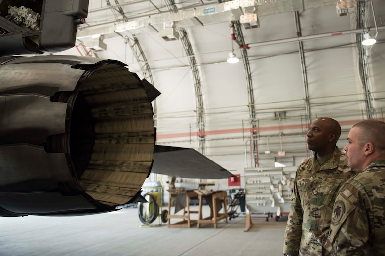 Chief Master Sgt. of the Air Force Kaleth O. Wright discusses the F-16 Fighting Falcon engine with a 455th Expeditionary Aircraft Maintenance Squadron Airman during a visit to Bagram Airfield, Afghanistan, Dec. 25, 2018. Wright spent much of the day touring facilities and gaining insight into the base's current mission sets. (U.S. Air Force photo by Senior Airman Kaylee Dubois)
