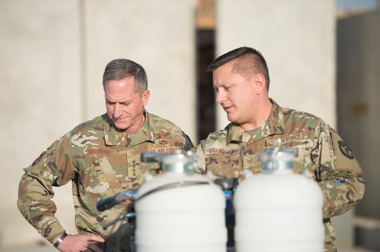 Air Force Chief of Staff Gen. David L. Goldfein visited with Airmen from the 455th Civil Engineer Squadron at Bagram Airfield, Afghanistan, Dec. 25, 2018. During the visit Goldfein learned about the work Airmen did to repaint airfield markings. (U.S. Air Force photo by Senior Airman Rito Smith)