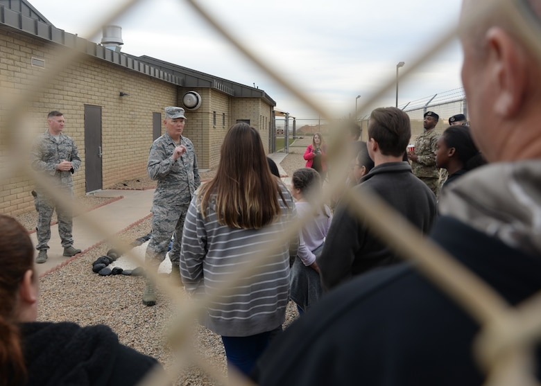 "Col. Robert Sylvester, 56th Mission Support Group commander speaks to the children of Childhelp during the ""Day of Hope"" event at Luke Air Force Base, Ariz., Dec. 21, 2018."