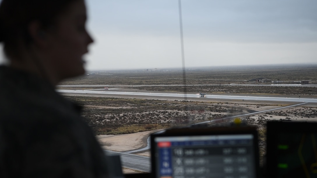 Senior Airman Kaitlyn Hopp, 54th Operations Support Squadron air traffic controller, gives a traffic call as an F-16 Fighting Falcon takes off, Dec. 18, 2018, on Holloman Air Force Base, N.M. Before an F-16 can take off or land they must be in contact with the air traffic control tower to ensure the runway is clear. (U.S. Air Force photo by Staff Sgt. BreeAnn Sachs)