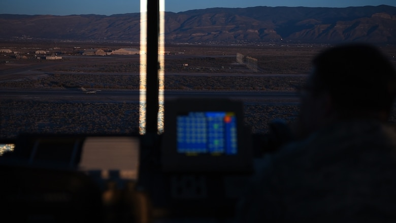 Staff Sgt. Alexander Kasper, 54th Operations Support Squadron air traffic controller, watches an F-16 Fighting Falcon land, Dec. 18, 2018, on Holloman Air Force Base, N.M. Before an F-16 can take off or land they must be in contact with the air traffic control tower to ensure the runway is clear. (U.S. Air Force photo by Staff Sgt. BreeAnn Sachs)