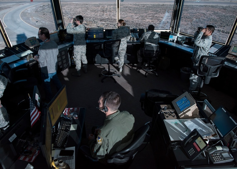 54th Operations Support Squadron air traffic controllers observe F-16 Fighting Falcons taking off, Dec. 20, on Holloman Air Force Base, N.M. The air traffic control tower is divided into five positions with unique responsibilities including ground transportation, flight data, local control, the watch supervisor desk and the supervisor of flight desk (U.S. Air Force photo by Staff Sgt. BreeAnn Sachs)