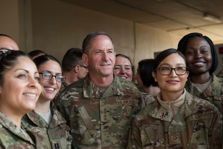 Air Force Chief of Staff Gen. David L. Goldfein stands for a photo with Airmen at Bagram Airfield, Afghanistan, Dec. 25, 2018. Goldfein and Chief Master Sgt. of the Air Force Kaleth O. Wright visited Airmen throughout U.S. Central Command's area of responsibility to offer guidance, thanks, and listen to Airmen's stories. (U.S. Air Force photo by Senior Airman Kaylee Dubois)