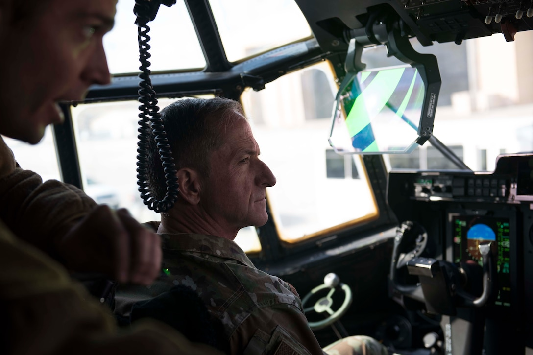Air Force Chief of Staff Gen. David L. Goldfein listens to Capt. Zachary Tolbert, 774th Expeditionary Airlift Squadron pilot, talk about the C-130J Super Hercules mission at Bagram Airfield, Afghanistan, Dec. 25, 2018. Goldfein and Chief Master Sgt. of the Air Force Kaleth O. Wright visited Airmen throughout U.S. Central Command's area of responsibility to offer guidance and thank them for their contributions to the mission. (U.S. Air Force photo by Senior Airman Kaylee Dubois)