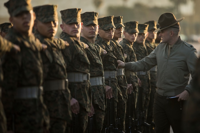 Recruits with Alpha Company, 1st Recruit Training Battalion, are getting evaluated during a final drill evaluation at Marine Corps Recruit Depot San Diego, Dec. 22. During evaluations, drillmasters score the platoons based on their uniforms, bearing, movements, as well as the drill instructor's cadence and sword control. Annually, more than 17,000 males recruited from the Western Recruiting Region are trained at MCRD San Diego. Alpha Company is scheduled to graduate Feb. 1.