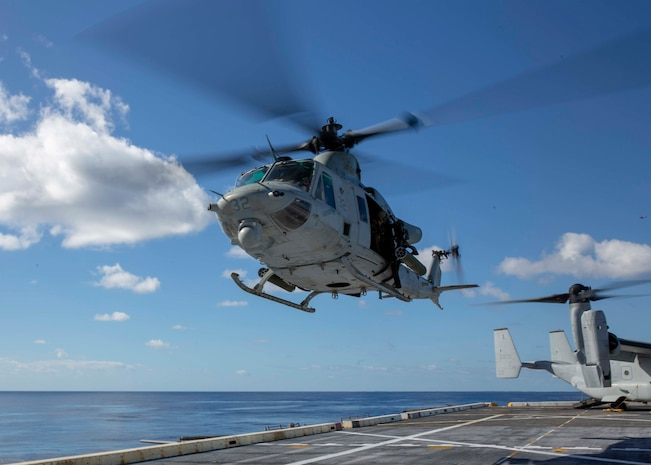 "A Marine UH-1Y ""Huey"" utility helicopter from Marine Medium Tiltrotor Squadron 264, 22nd Marine Expeditionary Unit, lands on the flight deck of the USS Arlington, Dec. 24, 2018. The USS Arlington is making a scheduled deployment as part of the Kearsarge Amphibious Ready Group in support of maritime security operations, crisis response and theatre security cooperation, while also providing a forward Naval presence."