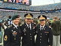 """From left to right, Sgt.1st Class Philip Nordstrom, Col. Mark Nordstrom and 1st Lt. Joel Nordstrom enjoyed a day at a Carolina Panthers """"Salute to Service"""" football game where Col. Nordstrom gave the opening invocation before the game.  (Photo Credit: Photo courtesy of Sgt. 1st Class Philip Nordstrom)"""