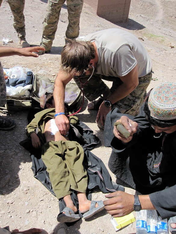A young Afghan boy was injured by shrapnel in his village. Sgt. 1st Class Philip Nordstrom treated the boy after he was injured.