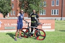 Sgt. 1st Class Jermond Awkward, U.S. Army recruiter and friend to Sgt. 1st Class Michael Smith, assisted Smith while training to become a Paralympic triathlete. Awkward said Smith is the most resilient man he knows.