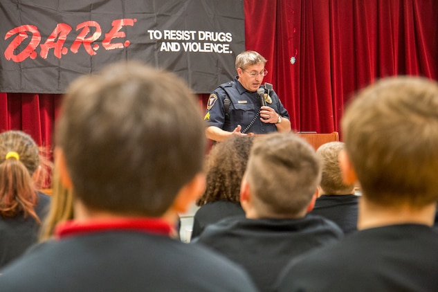 Cpl. Chris Stephens speaks to students at the graduation of the Drug Abuse Resistance Education program at Laurel Bay, Dec. 17. The goal of the program is the educate students
