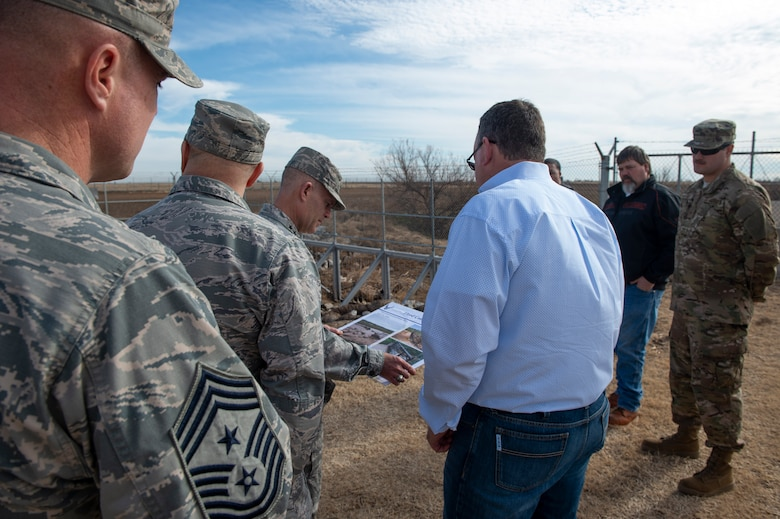 97th Civil Engineer Squadron operations flight shows the innovative improvements made to the gate to U.S. Air Force Lt. Gen. Steven Kwast, commander of Air Education and Training Command and 97th Air Mobility Wing leadership, Dec. 18, 2018, at Altus Air Force Base, Okla.  Several innovative accomplishments implemented by the 97th AMW were highlighted during the tour for Kwast. (U.S. Air Force photo by Senior Airman Cody Dowell)