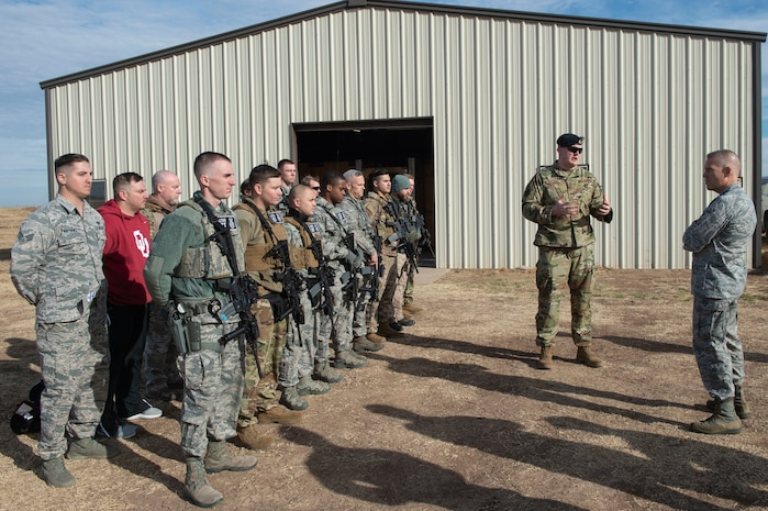 U.S. Air Force Capt. Nathan Bratka, operations officer assigned to the 97th Security Forces Squadron, introduces the members of the 97th SFS Emergency Service Team to Lt. Gen. Steven Kwast, commander of Air Education and Training Command, Dec. 18, 2018, at Altus Air Force Base, Okla. The emergency service team allows faster response with other organizations when more severe incidents occur on or off base. (U.S. Air Force photo by Senior Airman Cody Dowell)