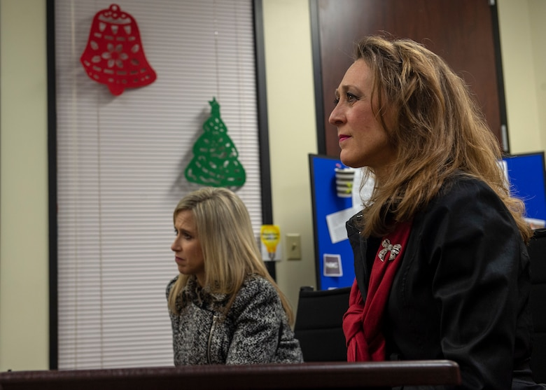 Joni Kwast, wife of U.S. Air Force Lt. Gen. Steven Kwast, commander of Air Education and Training Command, sits beside Tammy Carney, wife of Col. Eric Carney, 97th Air Mobility Wing commander, during an Airman and Family Readiness Center briefing, Dec. 18, 2018, at Altus Air Force Base, Okla. Kwast and Carney toured several locations on base that support the families of the Airmen. Kwast and her husband toured the base to learn more about how AETC can support Altus in future operations. (U.S. Air Force Photo by Senior Airman Jackson N. Haddon)