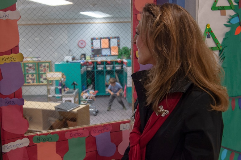 Joni Kwast, wife of U.S. Air Force Lt. Gen. Steven Kwast, commander of Air Education and Training Command, watches children play at the Child Development Center, Dec. 18, 2018, at Altus Air Force Base, Okla. The tours were designed so they could learn more about the inner workings of the base and how AETC can support it in future operations. (U.S. Air Force Photo by Senior Airman Jackson N. Haddon)