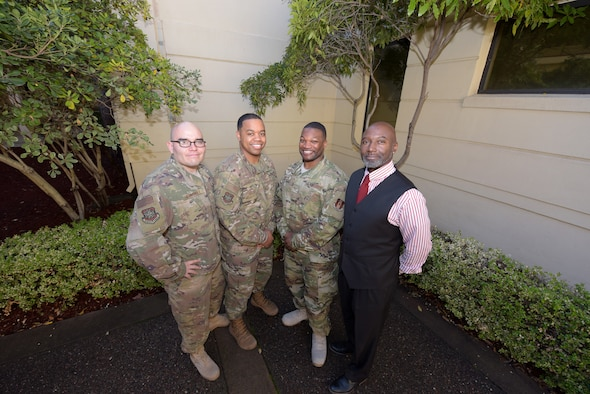 From left to right, U.S. Air Force Staff Sgt. Erick Hernandez, 60th Air Mobility Wing Equal Opportunity counselor, Air Force Staff Sgt. Baso Harper III, 60th AMW EO counselor, Air Force Tech. Sgt. Piankhy Richberg, 60th AMW EO NCO in charge and Grayland Hilt, 60th AMW EO director, pose for a photo Dec. 17, 2018, at Travis Air Force Base, California.. The EO office implemented a new conflict management program in June 2018 to help Airmen resolve conflict. (U.S. Air Force photo by Tech. Sgt. James Hodgman)