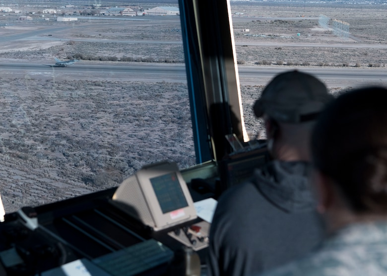 54th Operations Support Squadron air traffic controllers observe an F-16 Fighting Falcon take off, Dec. 18, on Holloman Air Force Base, N.M. Before an F-16 can take off or land they must be in contact with the air traffic control tower to ensure the runway is clear. (U.S. Air Force photo by Staff Sgt. BreeAnn Sachs)