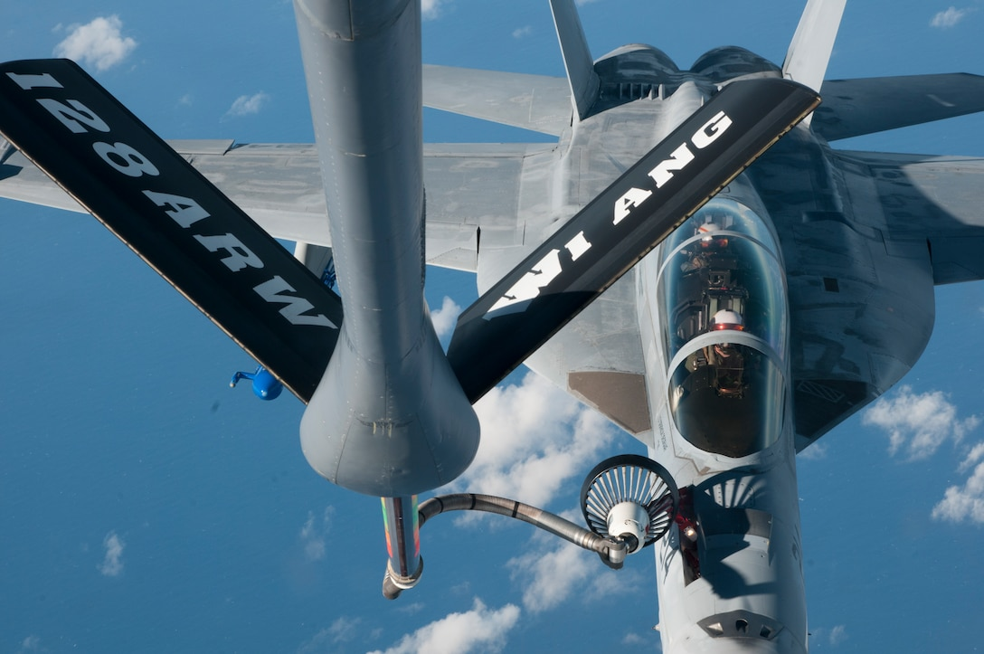 A U.S. Navy F/A-18 Hornet conducts air refueling operations Dec. 12, 2018, over the Pacific Ocean as part of a routine Sentry Aloha exercise.