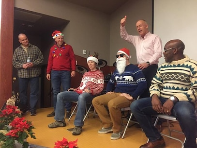 """Maj. Gen. Patrick J. Hermesmann, commander of U.S. Marine Corps Forces Korea, judges the """"Ugly Sweater"""" Competition during the MARFORK Holiday Party here, Dec. 21.  Marines and families used the Pacific Victors Chapel for the holiday party to celebrate the command's accomplishments, strengthen relationships within the command, and share their common fellowship with each other."""