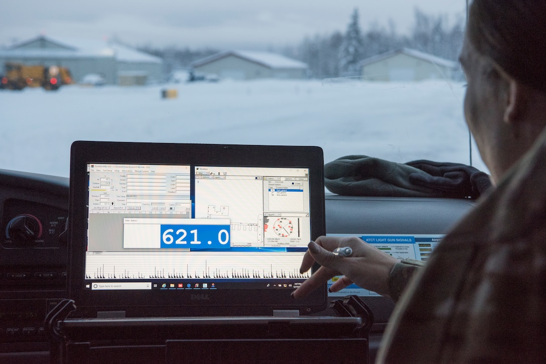 U.S. Air Force Master Sgt. Jill Reed, Air Force Civil Engineer Center's Airfield Pavement Evaluation Team superintendent, uses Geographical information surveying software to test the structural capacity of the pavement during an evaluation of Bryant Army Airfield at Joint Base Elmendorf-Richardson, Alaska Dec. 17, 2018. A two-person team used non-destructive testing to assess potential non-visible pavement damage at all of JBER's airfields following the Nov. 30, 7.0 magnitude earthquake, whose epicenter was located just north of the base. The deflectometer simulates 55,000 pounds of weight hitting the pavement at once. (U.S. Air Force photo by Airman 1st Class Crystal A. Jenkins)