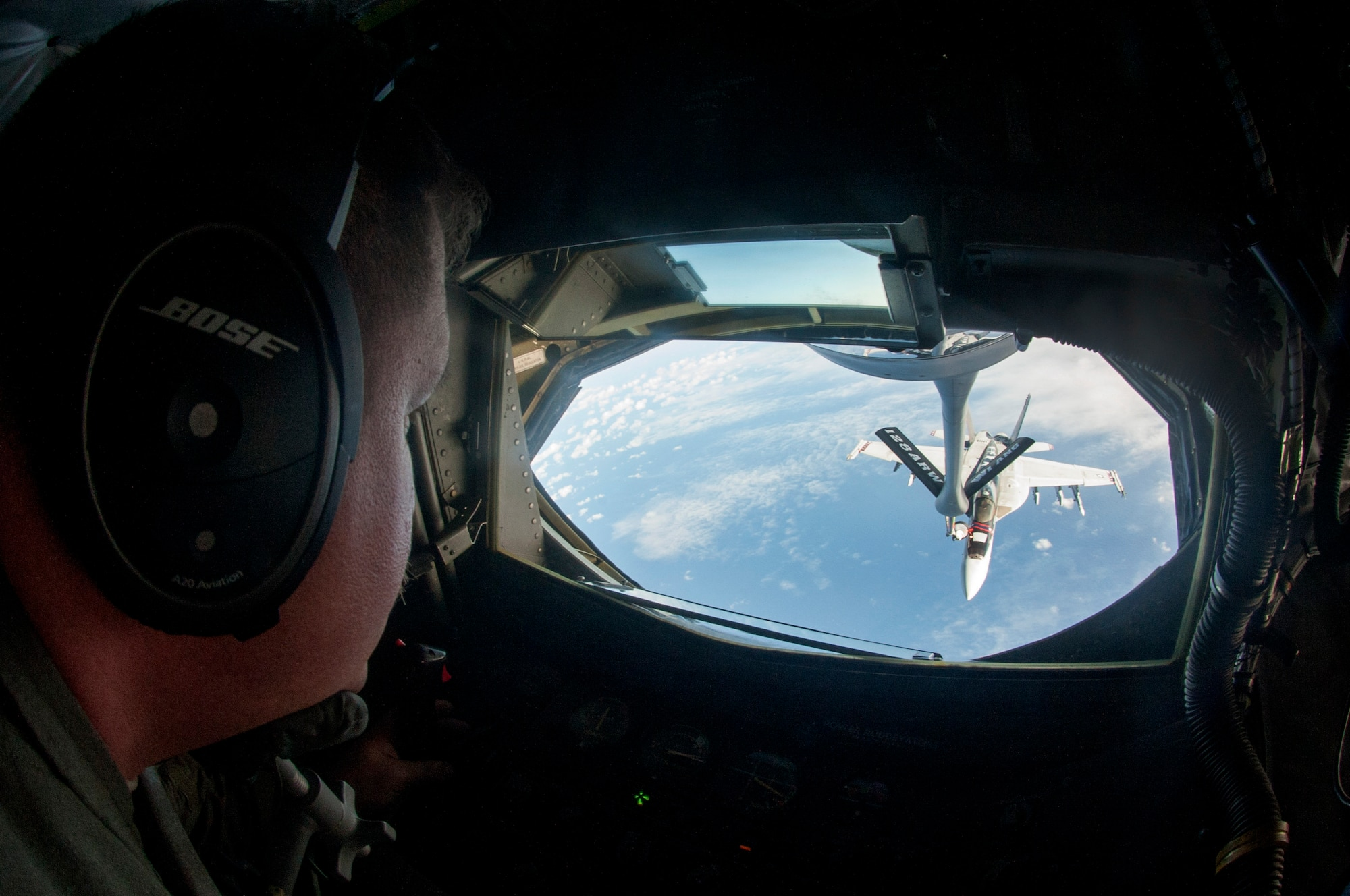 Master Sgt. Anthony Walter, 128th Air Refueling Squadron boom operator, conducts air refueling operations with an U.S. Navy F/A-18 Hornet Dec. 12, 2018
