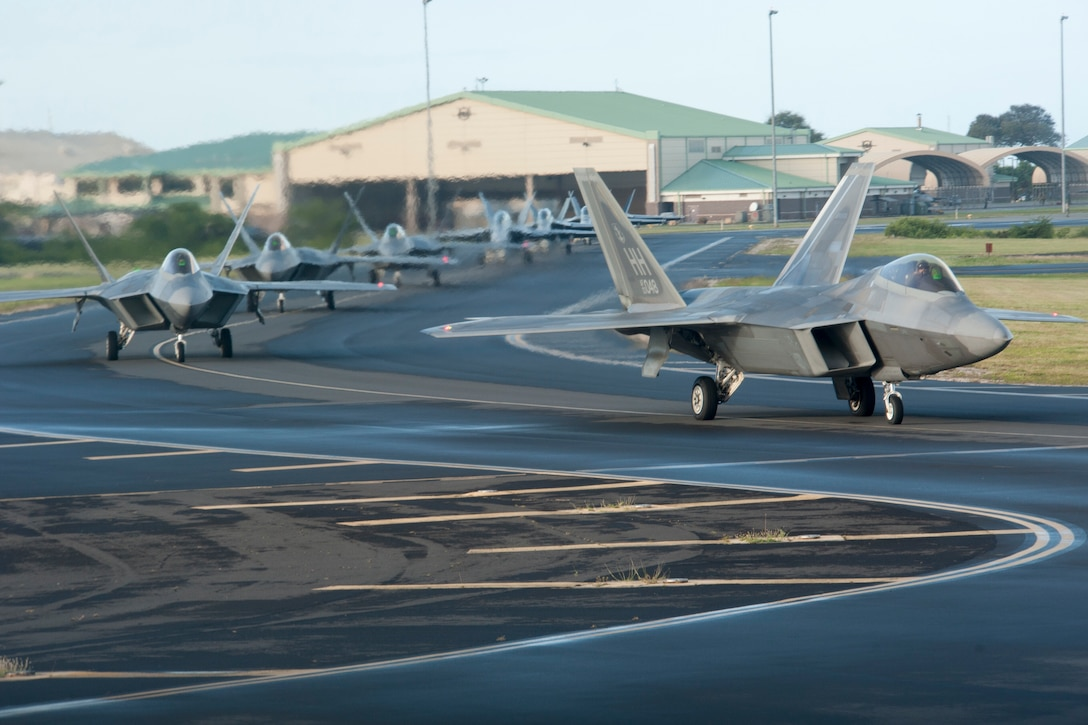 Hawaii Air National Guard F-22 Raptors from the 199th and 19th Fighter Squadrons taxi down the Joint Base Pearl Harbor-Hickam flight line Dec. 11, 2018