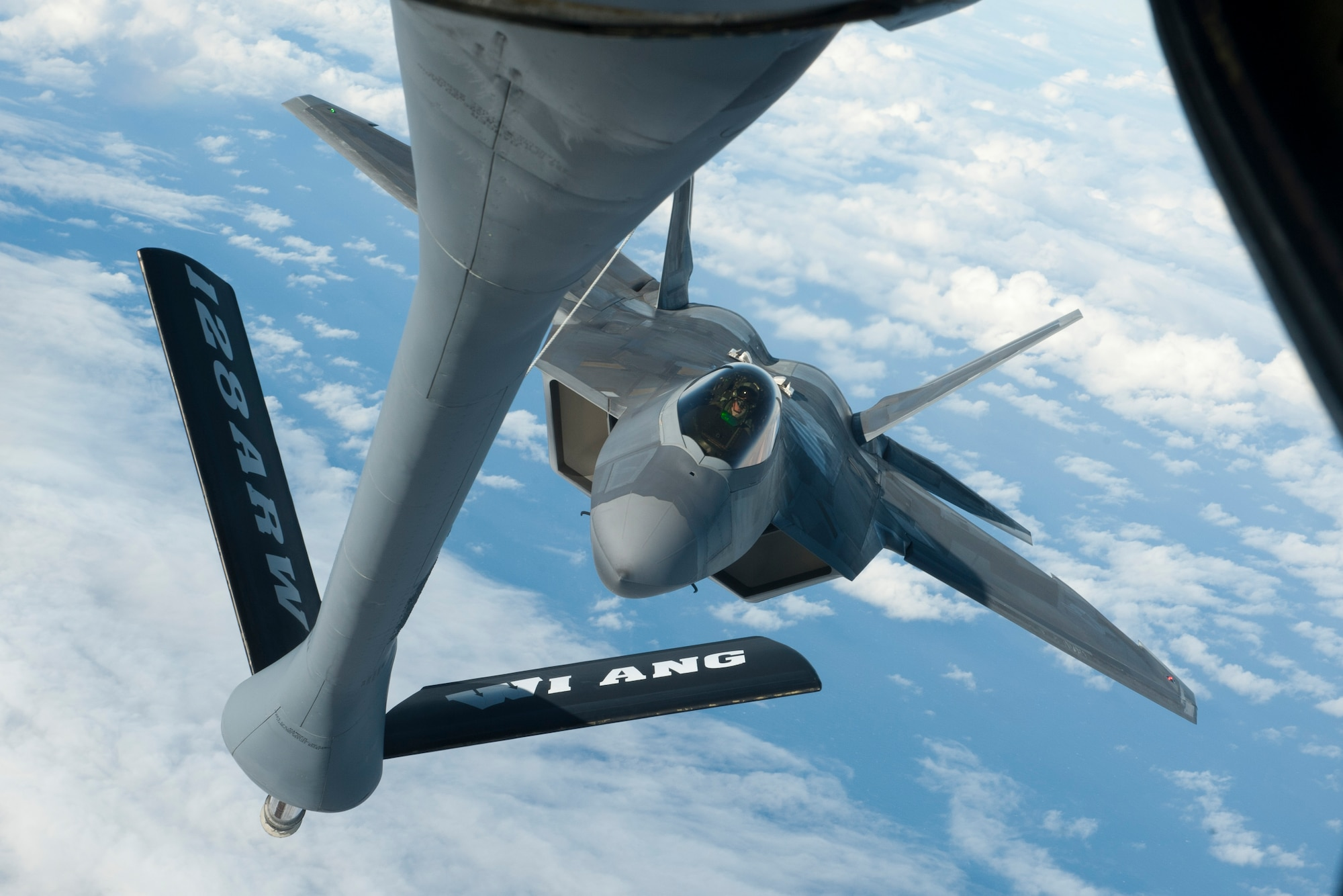 A Hawaii Air National Guard F-22 Raptor approaches a Wisconsin Air National Guard KC-135 Stratotanker to receive aerial refueling Dec. 11, 2018, over the Pacific Ocean, near the Hawaiian Islands