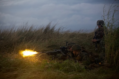 U.S. Marines with Charlie Company, Battalion Landing Team 1/4 fire at a notional enemy force using blank rounds during a helicopter raid as part of the 31st Marine Expeditionary Unit's MEU Exercise at Ie Shima Training Facility, Okinawa, Japan, Dec. 11, 2018.