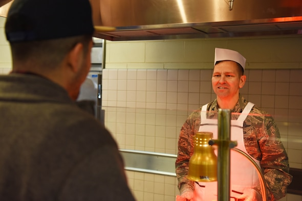 U.S. Air Force Col. Jon Wheeler, 8th Fighter Wing vice commander, takes an order during a holiday meal at Kunsan Air Base, Republic of Korea, Dec. 25, 2018. Leaders from the 8th Fighter Wing served meals to Airmen who spent the holiday away from home. (U.S. Air Force photo by Staff Sgt. Joshua Edwards)