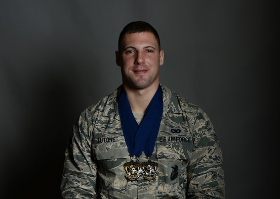 U.S. Air Force Senior Airman Andrew Tutone, 8th Security Forces Squadron pass and identification specialist, poses with 2018 Air Force Defender Challenge medals at Kunsan Air Base, Republic of Korea, Dec. 20, 2018. Tutone competed in the first Air Force Defender Challenge in 14 years, taking home the 2018 Air Force Defender Challenge Champions title with his U.S. Pacific Air Forces team Sept. 10 to 13, 2018, at Joint Base San Antonio-Camp Bullis, Texas. (U.S. Air Force photo by Senior Airman Savannah L. Waters)