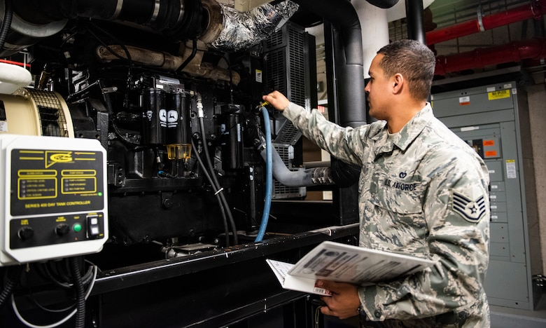 U.S. Air Force Staff Sgt. Bryson Ott, 8th Civil Engineer Squadron generator systems non-comissioned officer in charge, checks the poil level on a diesel generator at Kunsan Air Base, Republic of Korea, Dec. 20, 2018. Critical resources such as medical and security forces are equipped with emergency power systems that can provide their facilities with power for several days before refueling. (U.S. Air Force photo by Senior Airman Stefan Alvarez)