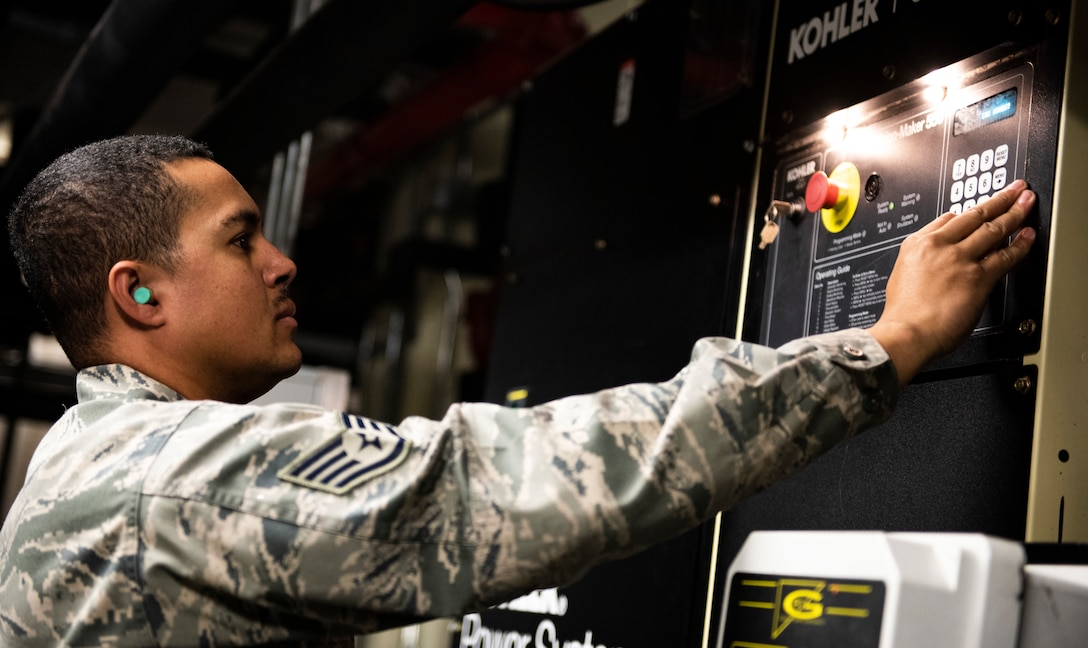 U.S. Air Force Staff Sgt. Bryson Ott, 8th Civil Engineer Squadron generator systems non-comissioned officer in charge, checks the data readings of a diesel generator at Kunsan Air Base, Republic of Korea, Dec. 20, 2018. Several facilities are equipped with emergency power systems to keep their operations going in austere conditions. (U.S. Air Force photo by Senior Airman Stefan Alvarez)
