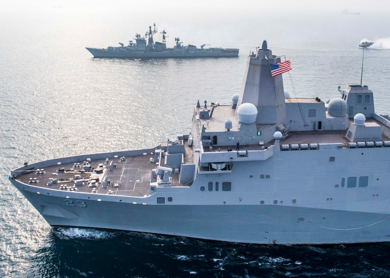 INDIAN OCEAN (Dec. 26, 2018) The San Antonio-class amphibious transport dock ship USS Anchorage (LPD 23), bottom, transits Bay of Bengal alongside Indian navy destroyer INS Rajput (D 51) while conducting a cooperative deployment with the Indian navy. Anchorage is deployed as part of the Essex Amphibious Ready Group (ARG) and 13th Marine Expeditionary Unit (MEU).